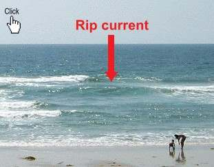 Rip Current :: Example of Rip Current, take notice to the texture of the water. A break in the incoming wave patern is one sign of a rip current
